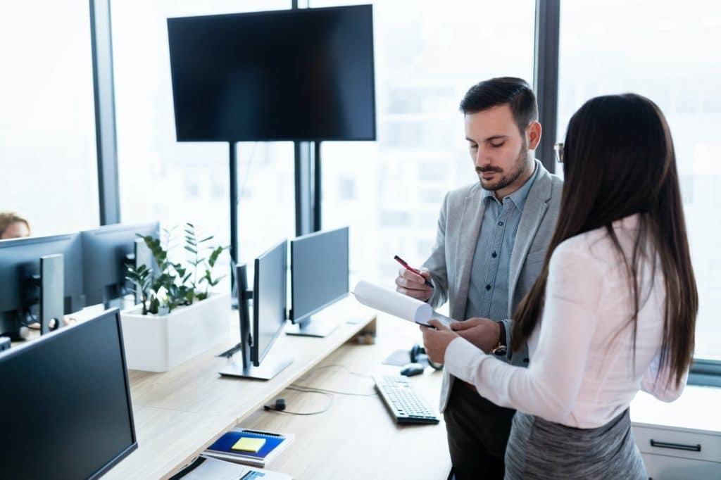 Portrait of business partners talking about finances